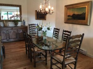 The dining room featuring Angela's antique elm and rush seat dining chairs and oak sideboard that were brought from England by Dick Beer (our founder and Angela's husband) in the early 1970's.