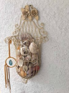 A dream catcher and lovingly collected seashells from the 1970's to recently.